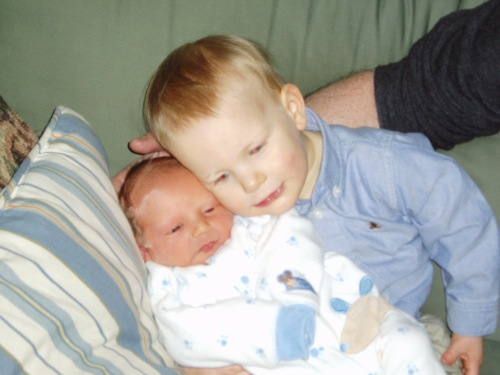 that one just cause they are cute... Collin and his then newborn brother Liam (Liam is now 4) LOL